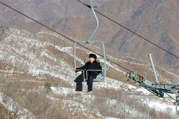 epa04004192 An undated handout picture made available by the Pyongyang's Rodong Sinmun on 31 December 2013, shows North Korean leader Kim Jong-un aboard a ski lift during his inspection tour at the Masik Pass ski resort, near Wonsan, North Korea.  EPA/RODONG SINMUN SOUTH KOREA OUT HANDOUT EDITORIAL USE ONLY/NO SALES