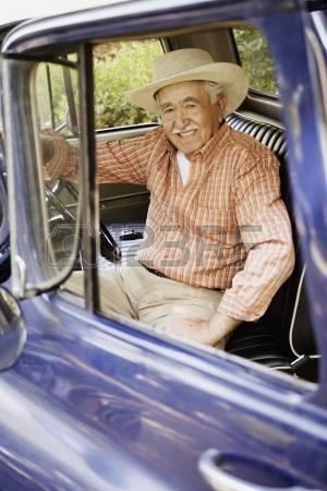 16072135-portrait-of-elderly-man-sitting-in-old-pickup-truck.jpg