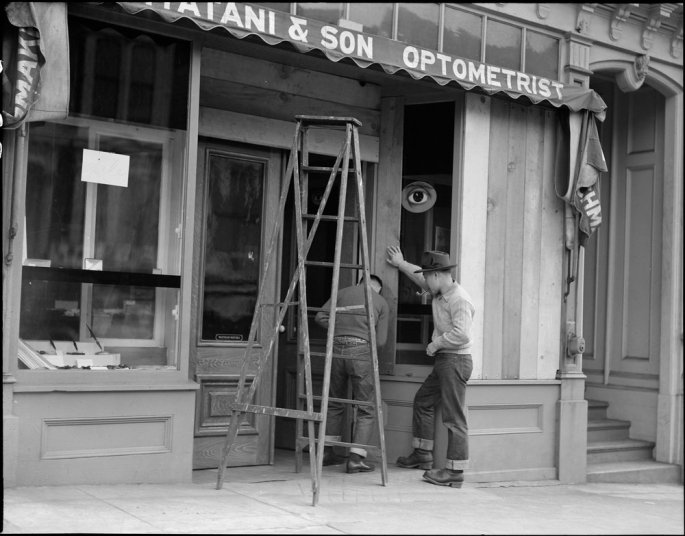 San Francisco, California. Owners of Japanese ancestry board up windows of their stores prior to evacuation. Evacuees will be housed in War Relocation Authority centers for the duration.