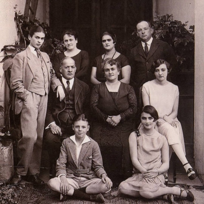 17-year old Frida Kahlo poses for a family photo wearing a 3-piece suit, 1924.jpg